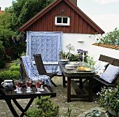 Laid garden table with chairs out of doors