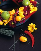 Arrangement of flowers and citrus fruit