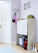 Cloakroom with storage space for household equipment