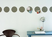 Home office: magnetic circles on wall for photos etc.
