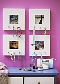 Jewellery hanging on picture frames above a chest of drawers