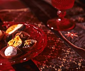 Assorted chocolates and sweets on glass plate (Christmas)