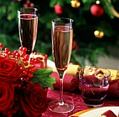 Glasses of champagne on decorated Christmas table