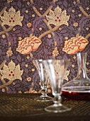 Wallpaper with a floral design and glasses with a carafe