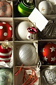Various Christmas tree baubles in a box