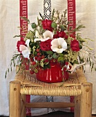 Arrangement of raspberries, mallow, poppy seed capsules & roses