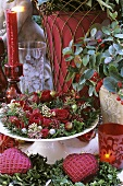 A Christmas wreath with roses and Gaultheria