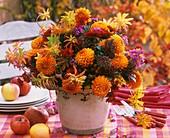 Arrangement of dahlias, skimmias, asters, euphorbia & chrysanthemums