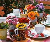 Small bunches of different summer flowers (table decoration)