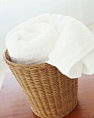 Rolled towel in basket