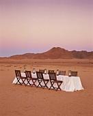 Empty dining table in desert