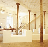 An exhibition space with a high ceiling