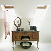 Mirror and containers on an old sideboard