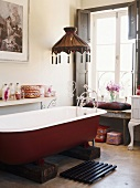 A bathtub with a lamp over it