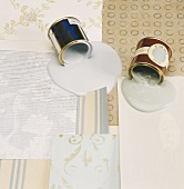 Wallpaper samples with spilt paint tins