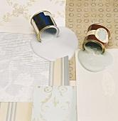 Wallpaper samples with spilt paint tins