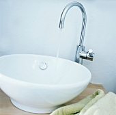 A wash basin with running tap