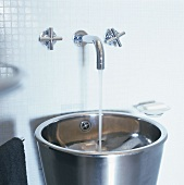 A stainless steel wash basin