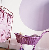 A bedstead and a doll's pram