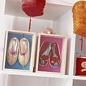 Lanterns hanging near shelving displaying Chinese shoes