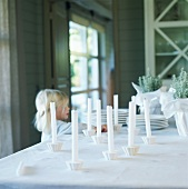 Little girl arranging candles on a table