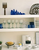 Shelves of crockery in a kitchen