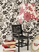 Chair against patterned wallpaper