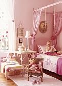 Little girl on child's bed