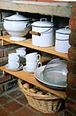 Pots and crockery on shelves