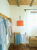 Clothing hanging on coat pegs