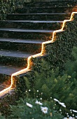 Exterior staircase illuminated with LED light strip