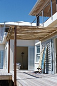 Roofed wooden veranda of holiday home