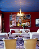 Living room with white sofa combination, large wall hanging with Chinese motif, gilt stars on ceiling and Chinese silk rug