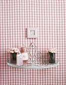 Small shelf on red and white gingham wall