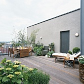 Set table, plants and lounger on terrace