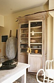 A cupboard in a kitchen