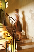 A woman going upstairs