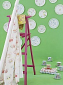 Plates hanging on green wall