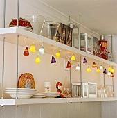 Shelving with lamps