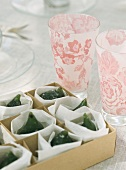 Glasses and candied green figs
