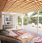 Chaise and rugs on roofed veranda