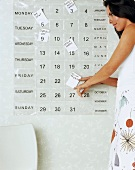 Young woman with calendar