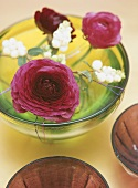 Flowers floating in glass dish