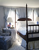 Grand bedroom with elaborately turned corner posts and blue and white textiles