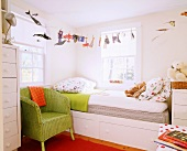 Child's bedroom with bed in corner, whimsical bed linen and bright accents of colour