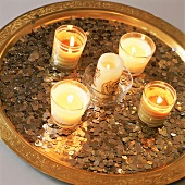 Lit candles on tray