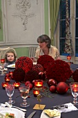 A mother and child at a festively laid table