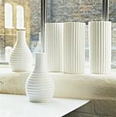 Still-life arrangement of vases in front of window