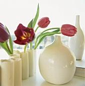 Red tulips in ceramic vase