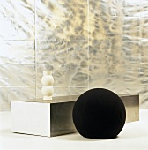 Spherical pouffe and low coffee table